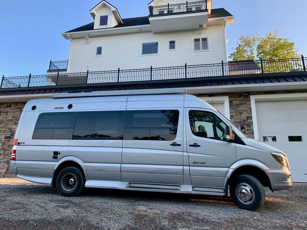 Camper Van in Front of House