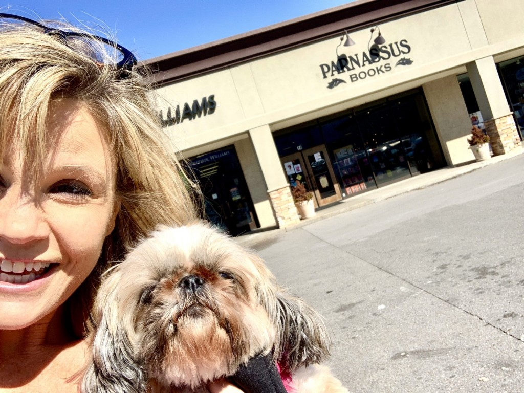 Woman and Dog in front of Parnassus Books